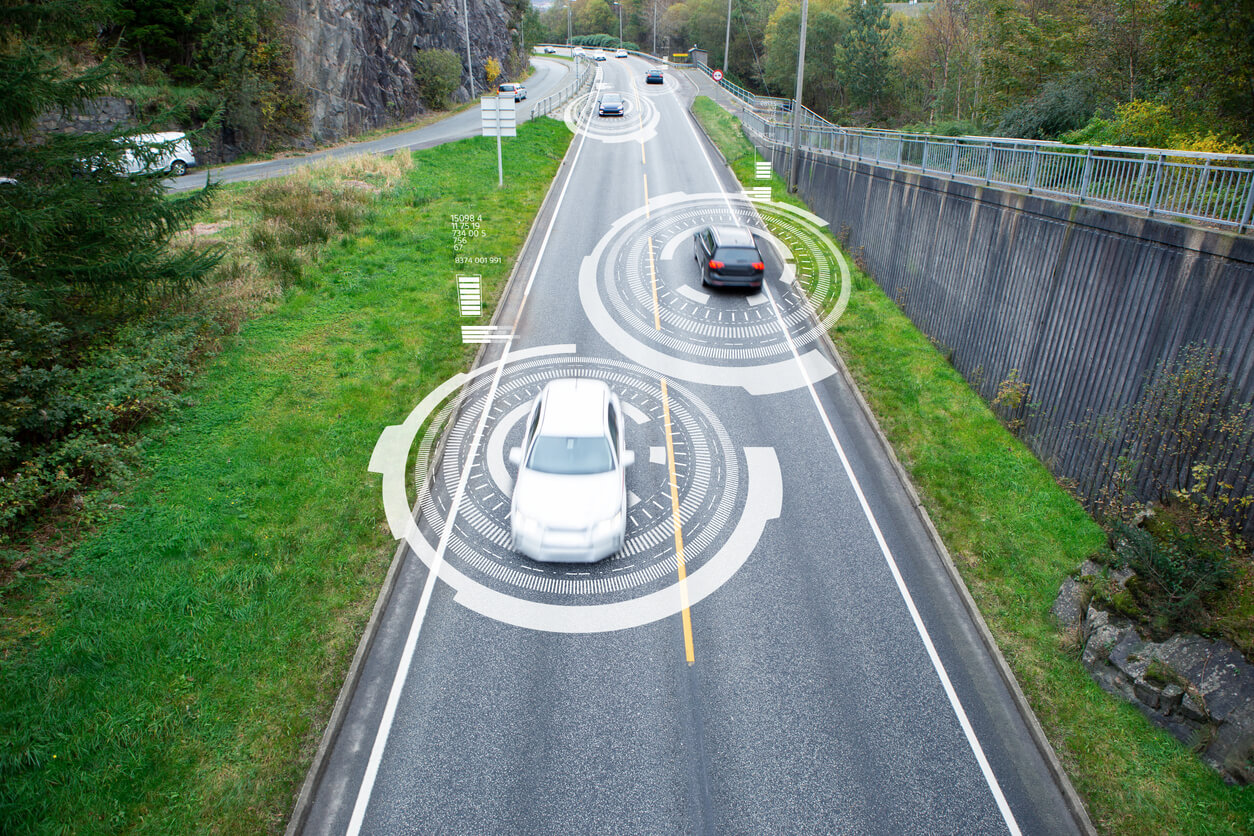 Self-driving cars driving on a road.