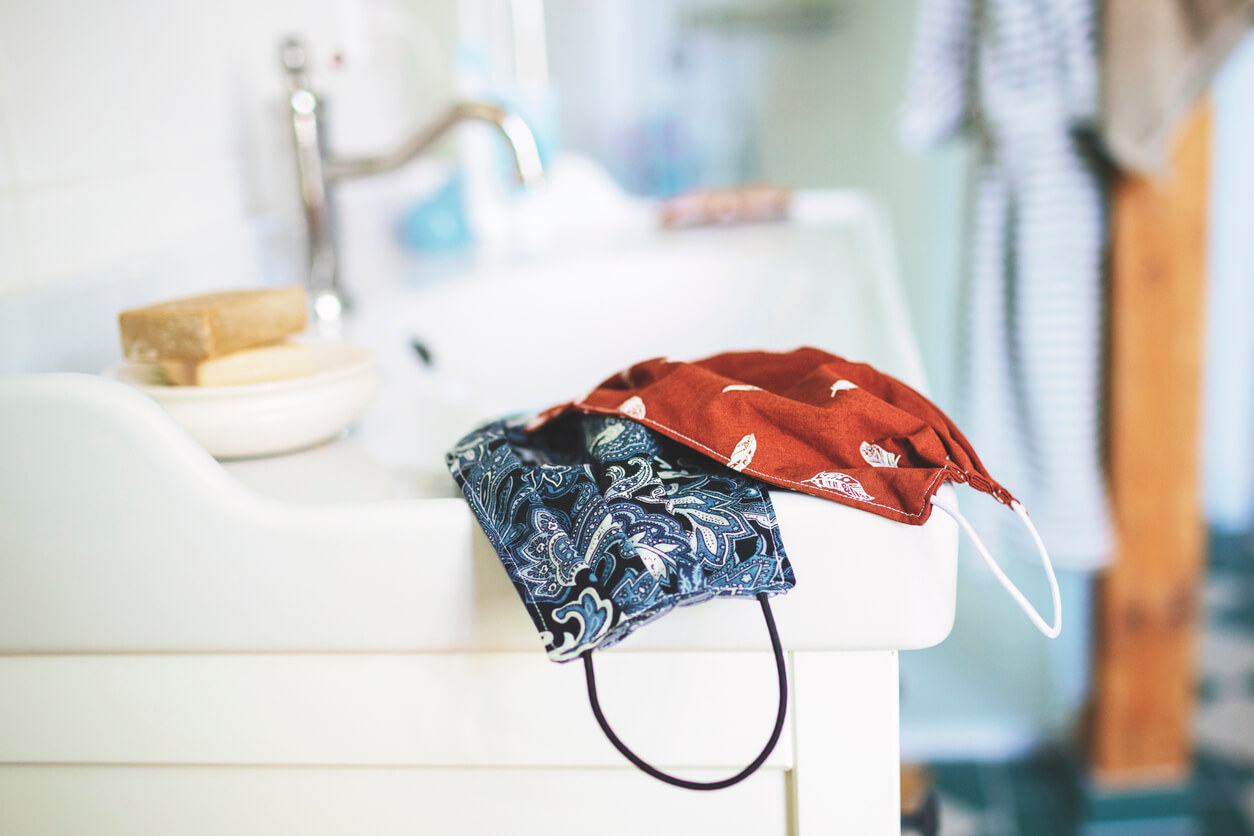 Fabric masks on top of sink.
