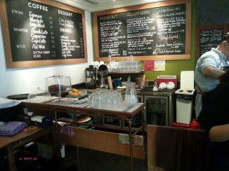 Behind the counter and Menu Board