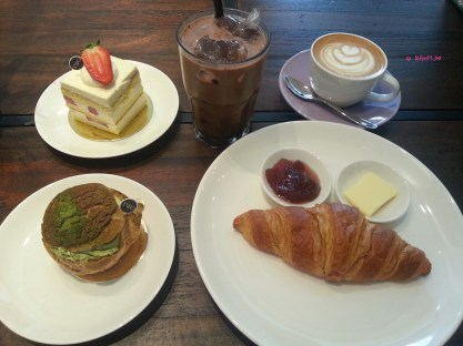 Our Order, (top left, anticlockwise): Strawberry Shortcake, Matcha Profiterole, Croissant, Cappuccino, Iced Chocolate