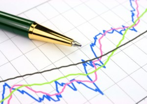 Colourful business chart and pen