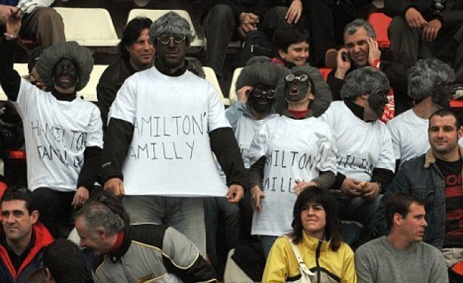 Spanish spectators who wore black face during the 2008 Circuit de Catalunya