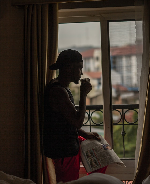 Young Man Looking out of Window - Technology and Africa ~ Nahwewe.com