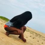 Adekunle Gold Spots Simi's Orange Pant In Beach Photos, Simi Reacts