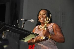 Patience Ozokwor receiving award on stage.
