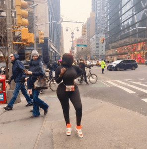 Princess Shyngle shared a new photo of herself in Pennsylvania but what most people noticed was the person who was focused on staring at her curvy backside. The Instagram model had on a bodysuit that hugged her curves. A woman passing by was seen turning to stare at Shyngle at the time the photo was taken and Instagram users commented on it.
