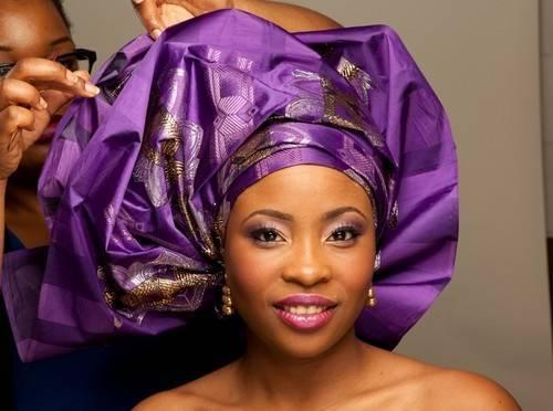 tying a purple gele for bride