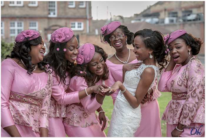 happy bride shows off wedding ring to bridesmaids
