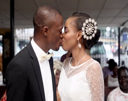 picture couple kissing white wedding nigeria