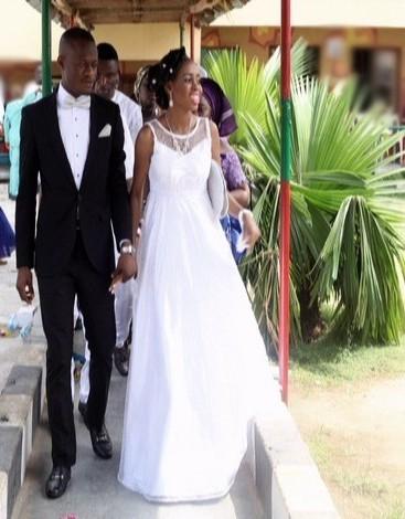 picture groom in black white suit n bride nigeria