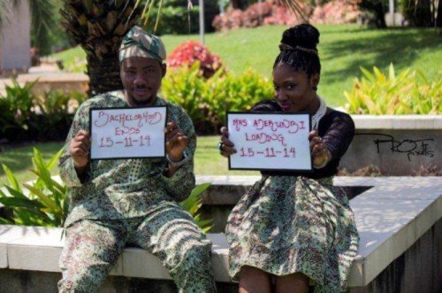 picture of nigerian couple flashing their 'save the wedding date'