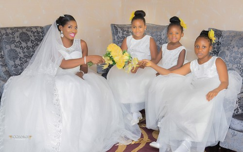 picture of flower girls with bride and yellow bouquet