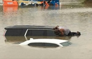 Houston Pastor Checks Submerged Cars to Ensure No One is Trapped
