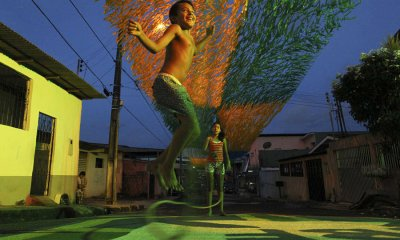 A boy jumps rope on Third Street of the Alvorada neighbourhood, which is painted with the logo of the Brazilian Soccer Confederation (CBF) and decorated for the 2014 World Cup, in Manaus [REUTERS]