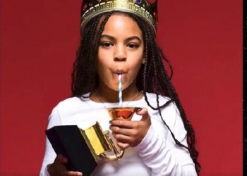 Blue sipping out of of Grammy award with a straw
