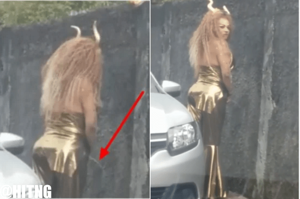 Pretty Lady Spotted Urinating On The Wall Like A Man (Watch Video)