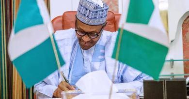 Buhari re-appoints Attahiru Jega