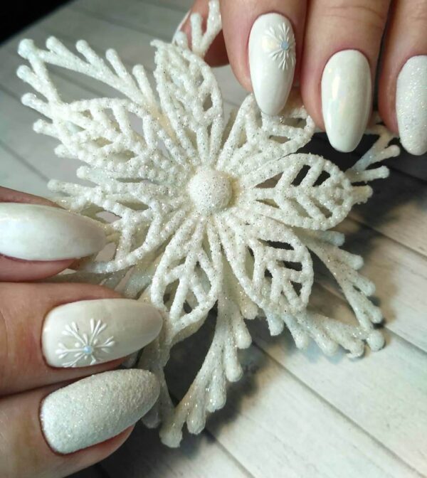 White manicure with New Year's design