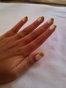 Step 2: Using your nail striper, apply the light green towards the end of your nails. THEY NEED NOT BE PERFECT.