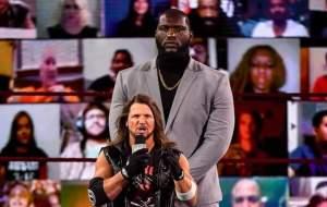 Jordan Omogbehin with AJ Styles