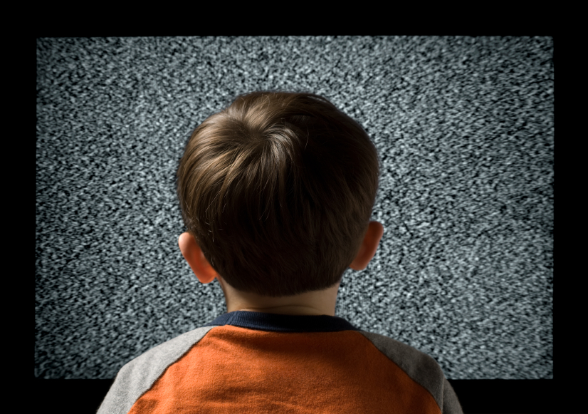 Young male child watching television metaphor