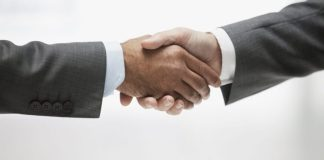 Businessmen shaking hands, close up