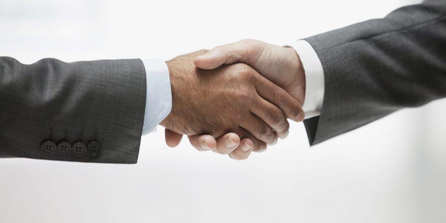 Businessmen shaking hands, close up