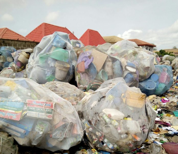 Assorted plastic bottles packaged in a sack and ready to be sold and recycled.