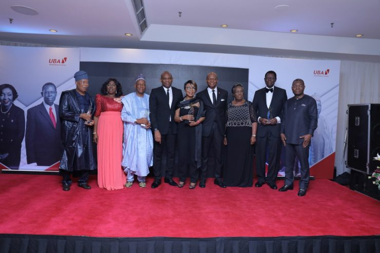 Choice 4: Appreciating Meritorious Services: l-r: Former Non-Executive Director, United Bank for Africa (UBA) Group, Mr. Yahaya Zekeri and wife, Clara; Former Non-Executive Director, Alhaji Jaafaru Paki; Group Chairman, Mr. Tony Elumelu; Former Non-Executive Director, Mrs. Rose Okwechime; GMD-CEO, Mr. Kennedy Uzoka; Former Non-Executive Director, Ambassador Adekunle Olumide and wife, Emeritus Professor Mercy Olumide; and Deputy Managing Director(DMD), Mr. Victor Osadolor during the send forth cocktail and dinner held by the Bank for the former Non-Executive Directors, held at Transcorp Hilton, Abuja on Friday