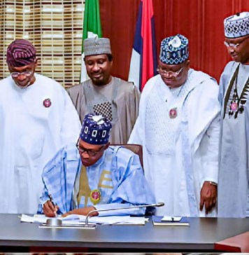 Budget: FG completes just 31.7% of constituency projects, Nigerians react to President Buhari's signing of Finance Bill