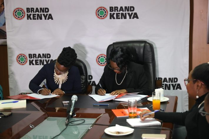 Ag. CEO Brand Kenya Board Ms Floice Mukabana (Right) signing a partnership deal to boost growth of the local fashion industry with Fashion Agenda Africa (FAA) Founder and fashion icon Akinyi E. Odongo (Left) at Brand Kenya Board offices this morning.