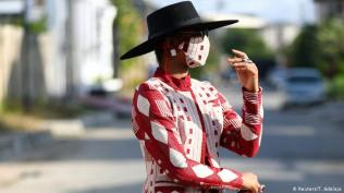 Lagos style Protecting yourself and others Lagos style: Nigerian fashion influencer Angel Obasi showcases her red and white face mask with matching clothes.