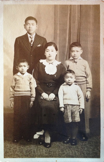 Studio portrait of Matsu Uyeda and family