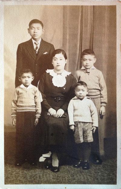 Studio portrait of Matsu Uyeda and family
