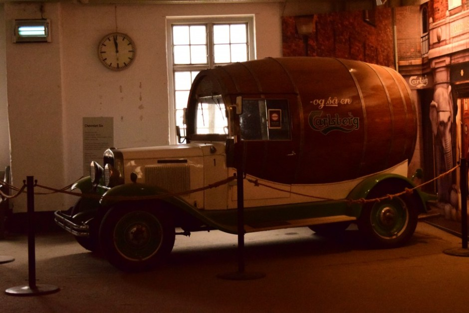 Carlsberg wagon that has a different design than most of the wagons. Looks like its a barrel on 4 wheels. Delivering beer all over Denmark.