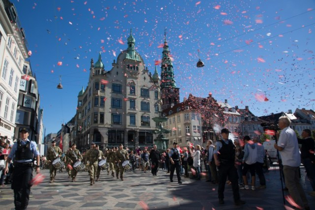 Soldiers from Operation Inherently Resolve hold 3 and Resolute Support Mission team 4 march from Stroget into City Hall on flag day for Denmark issued September 5, 2016.