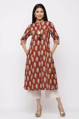 Contemporary print rust kurta with tassels.