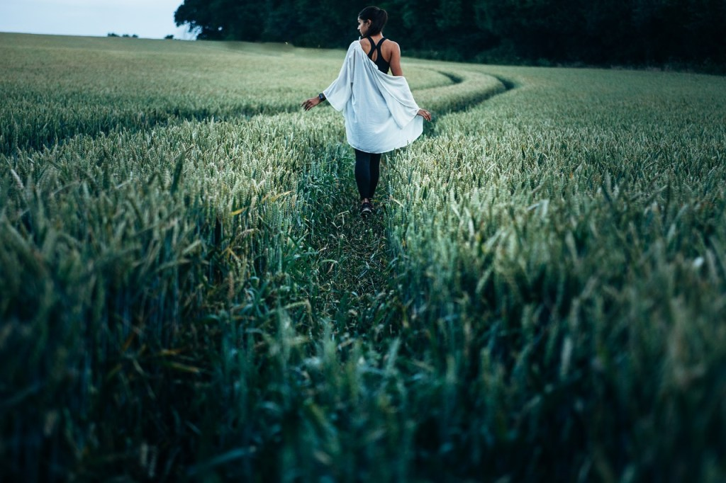 woman walking in green countryside