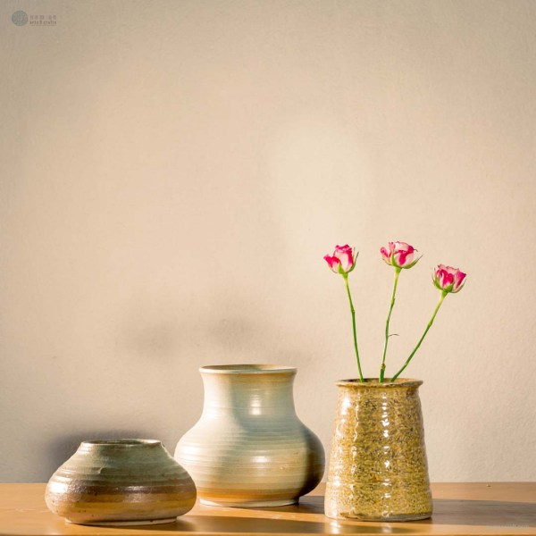 NA-desolated-field-horizontal-pattern-ceramic-vase-with-color-changes-from-green-gray-to-brown-yellow-made-by-artist-pham-anh-dao