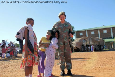 Col van Wyk poses with three admiring supporters