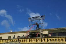 The lighting towers are being securely re-fastened with straps and cables