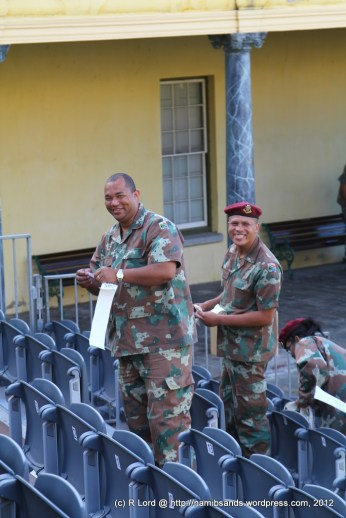 A team from 3 Medical Battalion Group is busy numbering another seating stand