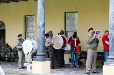 The drummers stand in for the 25-pounder guns