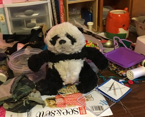 a panda on sewing table