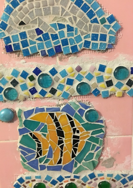 fish and dolphin with grout