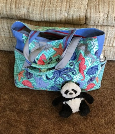 panda by suitcase