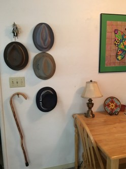 hats and cane wall