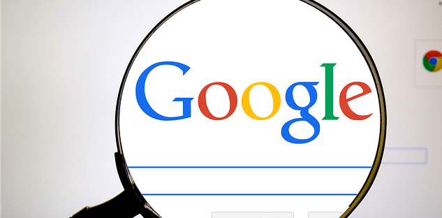 magnifying-glass-examining-google-search-trends