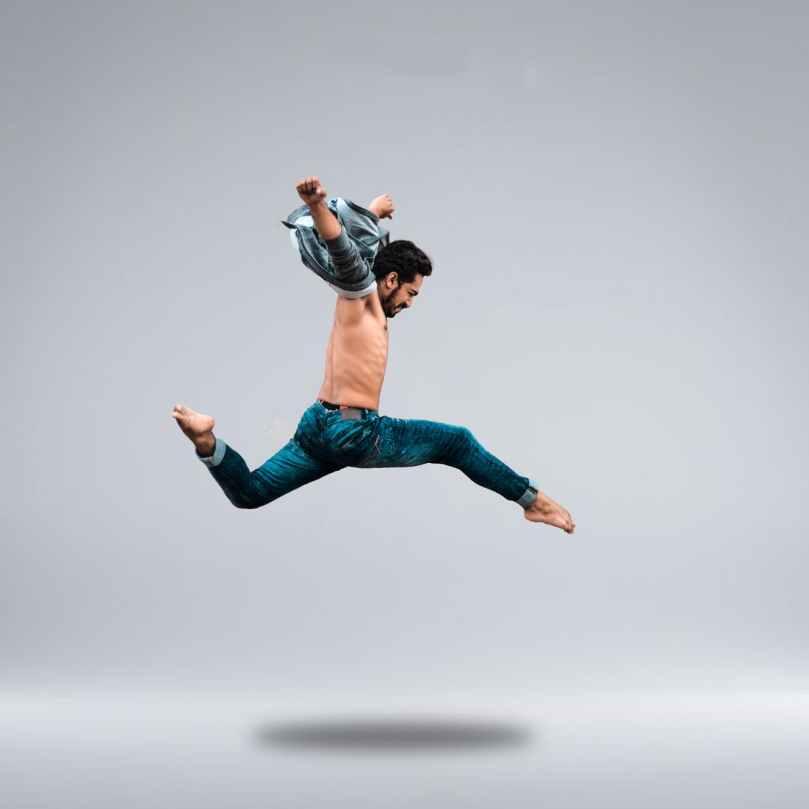man jumping high while posing