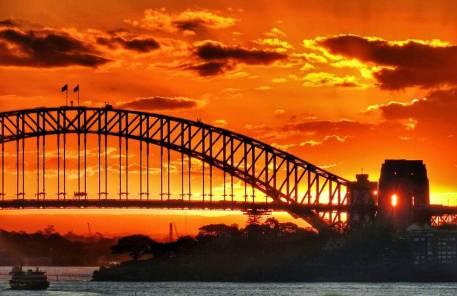 Beautiful skies silhouette Sydney Harbour Bridge.